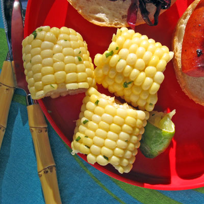 corn on the cobb with herb butter and lime