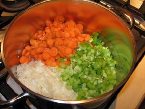 carrots celery and onion in pot