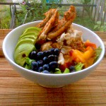 Salad of Frisse with Spatchcocked Chicken, Peaches, Avocado, and Blueberries