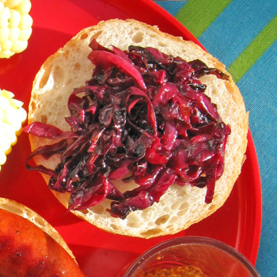 pickled red cabbage on barbequed sausage sandwich