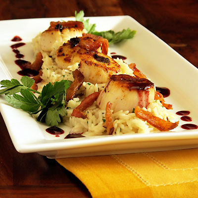 Scallops with mushroom risotto and blackberry sauce