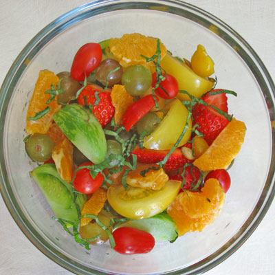 marinating fruit and tomato salad