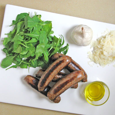 ingredients for grilled sausages and arugula pesto